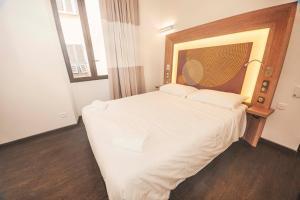 Un ou plusieurs lits dans un hébergement de l'établissement Kallisté