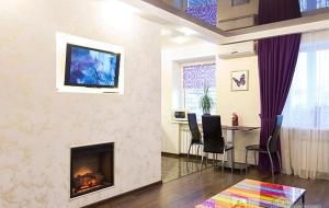 A television and/or entertainment center at Kharkiv Center Apartment on Hoholya Str, Poetry square