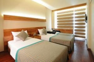 Кровать или кровати в номере Hotel Buyuk Keban