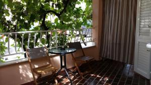 A balcony or terrace at Comfort Studio Apartment Vita