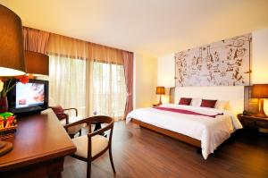 A bed or beds in a room at Navalai River Resort