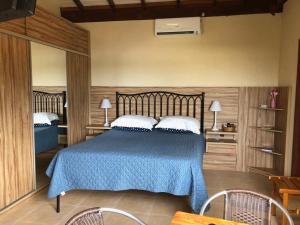 Cama ou camas em um quarto em Floripa Guest House