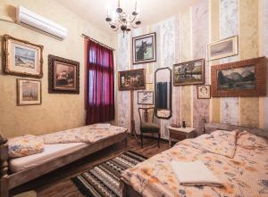 A bed or beds in a room at Guest House Malkia Inter
