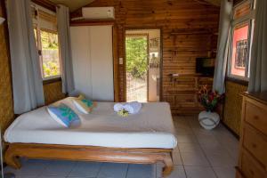 Cama ou camas em um quarto em Villa Moemoea