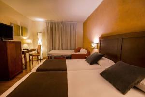 Cama o camas de una habitación en Magic Andorra