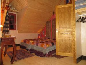 Un ou plusieurs lits dans un hébergement de l'établissement Gite Esprit du Monde