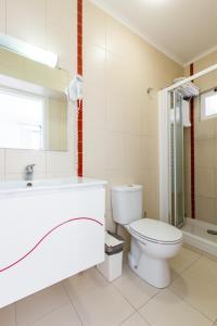 Uma casa de banho em Lisbon Inn Apartments