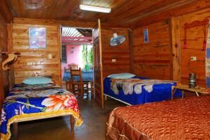 A bed or beds in a room at Villa Nena y Osiel