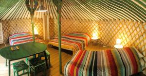 A bed or beds in a room at Yourtes Mongoles Gavarnie