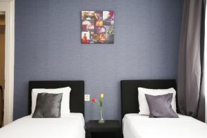 Un ou plusieurs lits dans un hébergement de l'établissement Hotel Flipper Amsterdam