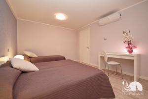 Letto o letti in una camera di Appartamento Valtenesi