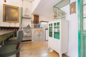 A kitchen or kitchenette at Casa San Telmo