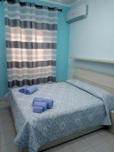 A bed or beds in a room at Casa di Jerry Castellabate 2