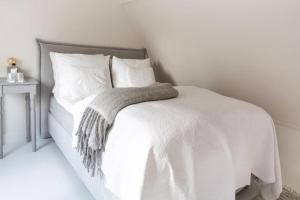 Un ou plusieurs lits dans un hébergement de l'établissement Maison de l'Epée