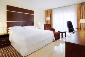 A bed or beds in a room at Sheraton Abuja Hotel