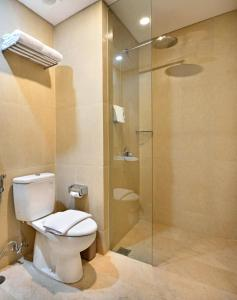 A bathroom at Whiz Prime Hotel Basuki Rahmat Malang