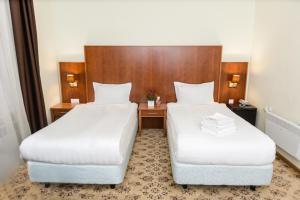 Cama o camas de una habitación en Matreshka Hotel