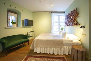 A bed or beds in a room at The Three Sisters Boutique Hotel