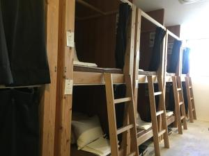 A bunk bed or bunk beds in a room at & AND Hostel