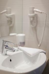 Un baño de Hotel Adria
