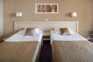 Cama o camas de una habitación en Hotel Adria