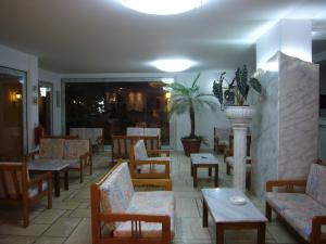 A restaurant or other place to eat at Atlantis Beach Hotel