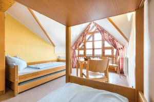 A bed or beds in a room at Jugendherberge Oberstdorf
