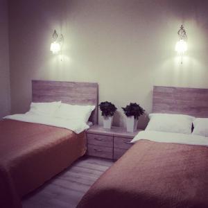 Кровать или кровати в номере Hotel XL
