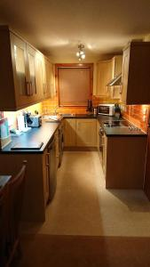 A kitchen or kitchenette at Castleyards Apartment 12