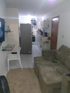 A seating area at apartamento mobiliado