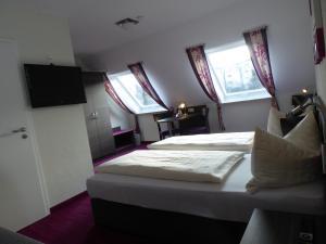 Ein Bett oder Betten in einem Zimmer der Unterkunft Pension am Weinberg Bed & Breakfest