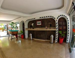 The lobby or reception area at Hotel Rio Malecon