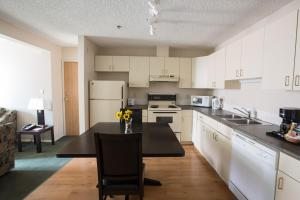 A kitchen or kitchenette at Capital Suites Yellowknife