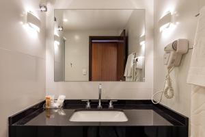 Um banheiro em Monthez Hotel & Eventos