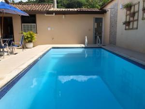 A piscina localizada em Pousada da Praia ou nos arredores