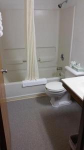 A bathroom at Super 8 by Wyndham Queensbury Glens Falls