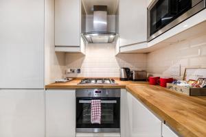 A kitchen or kitchenette at Birchanger House