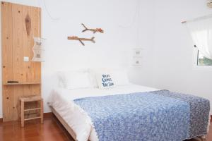 A bed or beds in a room at Utopia Guest House