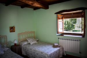 Cama o camas de una habitación en Casa Magosto