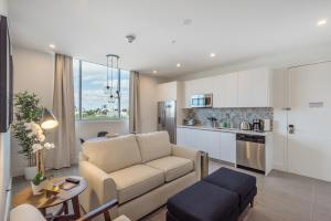A seating area at VHC Luxury Apartments