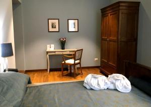 Кровать или кровати в номере Antica Locanda Leonardo
