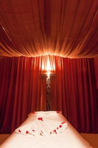 Un ou plusieurs lits dans un hébergement de l'établissement Atlas Medina & Spa