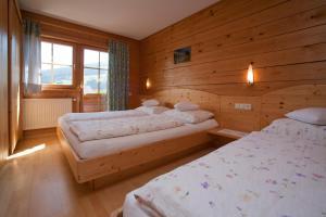 Postel nebo postele na pokoji v ubytování Abelhof
