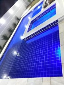 The swimming pool at or near RIVIERA DE SANTA CRISTINA XIII