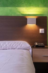 Cama o camas de una habitación en Apart-hotel Serrano Recoletos