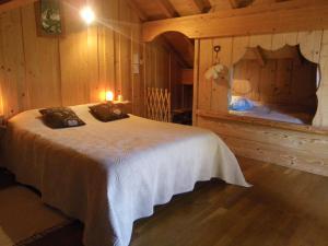 Un ou plusieurs lits dans un hébergement de l'établissement Chalet de campagne