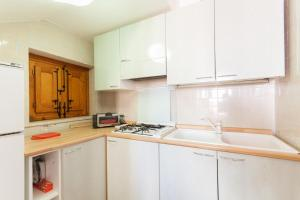 Cucina o angolo cottura di Sea and Relax San Vito Residence by Wonderful Italy
