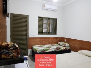 Cama ou camas em um quarto em Pousada Sao Caetano