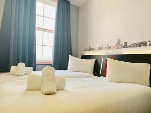 A bed or beds in a room at easyHotel Ipswich