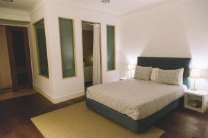 A bed or beds in a room at Asul B&B